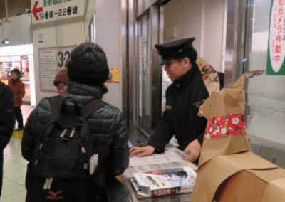 DOG buying Shinkansen ticket at Ueno