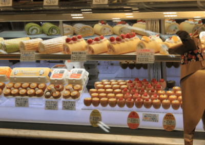 DOG looking at cakes in Ueno Station