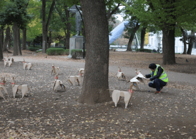 Staff member sets up installation in Ueno Park Tokyo