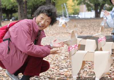 DOGTokyo2017 makes a woman smile in Ueno Park, Tokyo